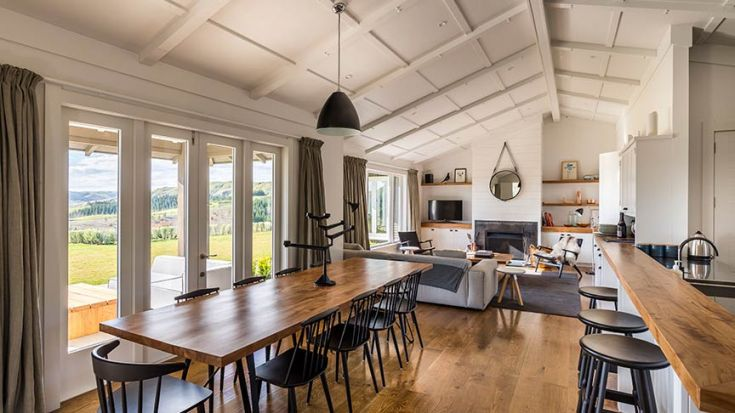 open lounge and dining space with wooden finishings