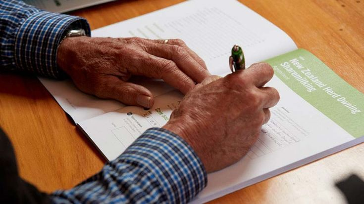 close up of someone filling in form at table